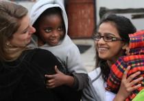 Nicole and Palak with kids at Philani