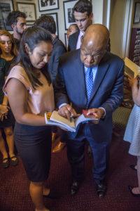 Congressman Lewis signs CeCe's book.